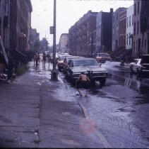 Image of [Playing in fire hydrant water] - 1977 Blackout Slide collection