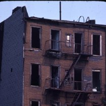 Image of [Back view of damaged building] - 1977 Blackout Slide collection