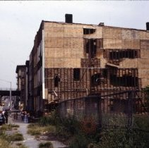 Image of [Side view of a building partially covered in plywood] - 1977 Blackout Slide collection