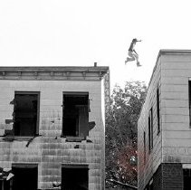 Image of [Man jumping from roof] - Lucille Fornasieri Gold photographs