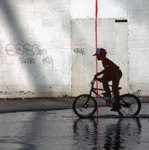 Image of [Boy on bike] - Lucille Fornasieri Gold photographs