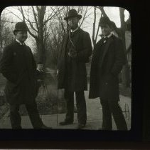 Image of [Three men and a boy standing on sidewalk in Brooklyn] - Adrian Vanderveer Martense collection