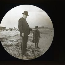 Image of [Man and boy standing on the beach, Coney Island] - Adrian Vanderveer Martense collection
