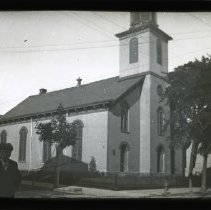 Image of [Boy standing in front of Dutch Reformed Church, Flatbush] - Adrian Vanderveer Martense collection