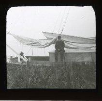 Image of [Men sitting on sailboat] - Adrian Vanderveer Martense collection