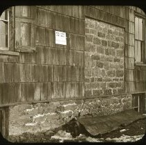Image of Side of Peck House, Lincoln [Avenue] and Pitkin [Avenue] - Ralph Irving Lloyd lantern slides