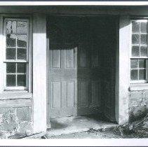Image of [Twelve Panel Door, West Side of Stone Building Next to Dwelling] - Watervliet, NY