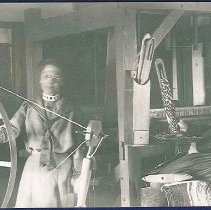 Image of [Mary Dahm (spinning) and Eva Larkin (weaving) at South Family, Watervliet, New York] - Watervliet, NY