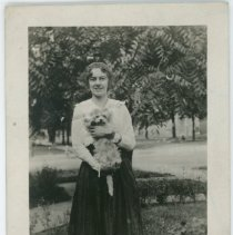Image of Betty (Price) Shetterby holding a dog.