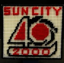 """Image of Sun City General - Cross stitched coaster saying """" SUN CITY 40 2000."""" Photo by Bob McColley."""