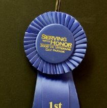Image of Sun City General - Sun City Poms first place ribbon on 2008 Veterans Day Parade.  Photo by Bob McColley.