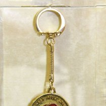 "Image of Del Webb - Del Webb's Company logo key chain saying:  ""Lively Adult Living  Arizona California Florida.""  Photo by Bob McColley."