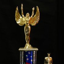 Image of Sun City General - Sun City Poms 2006 Glendale Veterans Day Parade Citizens Marching Unit trophy.  Photo by Bob McColley.