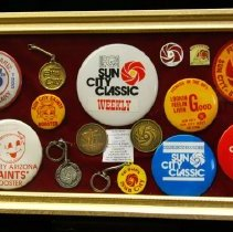 Image of Sun City General - Framed collage of Sun City and Del Webb's buttons and key chains.  Photo by Bob McColley.