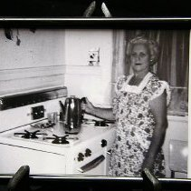 Image of 1960's Household - Picture of  a woman in her 1960 kitchen.  Part of the re-creation of 1960 kitchen.   Photo by Bob McColley.