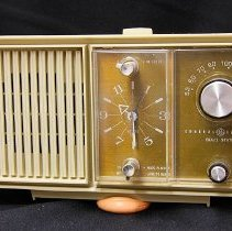 Image of 1960's Household - Electric GE clock radio model #C2420H light tan color.   Deed of gift by Jane Freeman on 1/31/06.  Photo by Bob McColley.   Part of re-creation of 1960 kitchen.