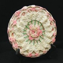Image of 1960's Household - Crocheted pink and white hot plate.  Photo by Bob McColley.  