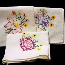 Image of 1960's Household - Three embroidered flower dish towels.   Photo by Bob McColley.