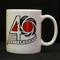 Image of 1960's Household - 40th Anniversary Sun City, Arizona coffee cup , white, black & red.  Deed of gift by Margo & Bill Newman on 3/17/10.   Photo by Bob McColley.  