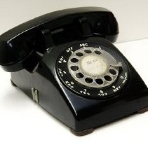 Image of 1960's Household - Black rotary dial telephone.  Photo by Bob McColley.   