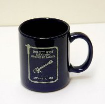 Image of Sun City West General - Sun City West Expansion Ground Breaking August 7, 1992 mug.  The mug is for sale at the museum for $2.50 in the gift shop.  Photo by Bob McColley.