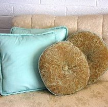 Image of 1960's Household - Two aqua rectangle pillows and two aqua and brown circular pillows.  Photo by Bob McColley.  