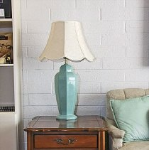 "Image of 1960's Household - 31"" turquoise base lamp with ecru fabric shade. Lamp was donated by the Lutheran Thrift Shop on 7/1/06.  Wooden end table with one drawer.