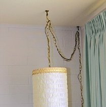 Image of 1960's Household - Hanging white and gold trim light.  Photo by Bob McColley.
