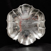 """Image of Sun City General - 10"""" oval dish engraved """"Del E. Webb Corporation   Runner Up 1966-67  John Morton.""""  Deed of gift from Ruth Morton on 8/12/02.  Photo by Bob McColley."""