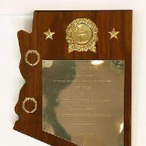 """Image of Del Webb - Turf Paradise plaque shaped like Arizona - """"Outstanding Sportsman & Businessman DEL WEBB  January 17, 1970 ...""""   Deed of gift from the R.H. Johnson Foundation Collection on 9/19//09.   Photo by Bob McColley."""
