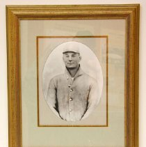 Image of Del Webb - Framed photo of young Del E. Webb in baseball uniform.  On loan from Marjorie Johnson, widow of R.H. Johnson on 11/14/09.   Photo by Bob McColley