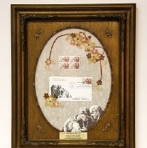 "Image of Sun City General - Framed display depicting senior years, with stamps and a postcard of the ""Aging Together"" twenty cent commemorative stamp.   This stamp was dedicated by the Postmaster General at the Sundial Recreation Center on May 21, 1982.    Deed of gift from Frederick Swanson on 10/22/02.  Display is engraved with ""Presented to Fred Swanson ""Again together"" .""  Photo by Bob McColley."