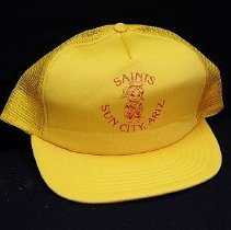 "Image of Sun City General - Yellow baseball cap with red lettering saying ""Saints  Sun City, Ariz.""    Deed of gift by Ed Allen on 12/6/10.  Photo by Bob McColley."