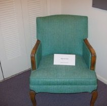 Image of Sun City General - Green wooden chair that was in a room at the Kings Inn.  It was donated by a neighbor of Billy Graves on 12/17/11.   Billy Graves was a secretary at DEVCO.