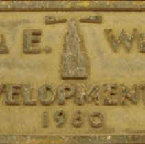 Image of Del E. Webb date plaque