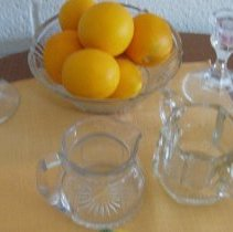 Image of Sun City General - Glass candle holders, bowl and  sugar and creamer containers .  They are exhibited on the dining room table and rotated with other items through out the year.  