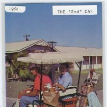 "Image of Postcard - Postcard of ""The 2nd Car"", a couple in their golf cart with golf clubs and groceries in the back."