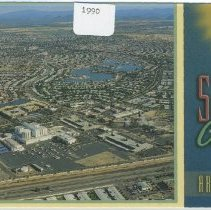 Image of Postcard - A 1990 postcard of the aerial view of Sun City with Boswell Hospital and Grand Avenue.