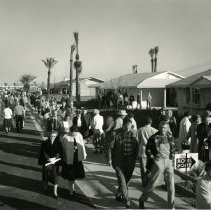 Image of Sun City General - Close-up of throngs visiting model homes and area on opening day, January 1, 1960.  
