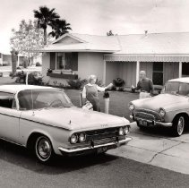Image of Sun City couple waves good-bye - Couple waving good-by outside a home.