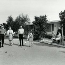 Image of Sports - General - Playing croquet on condominium lawn