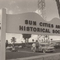 Image of Sun Cities Area Historical Society - Large standing sign bordering SCAHS house and Rec Center