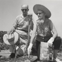Image of Working in Agricultural Center - Photo of unknown man and woman enriching the soil at the Agricultural Center