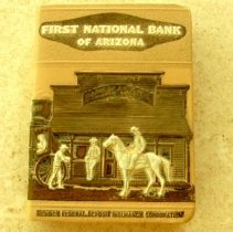 Image of Sun City General - Souvenir bank of Forst National Bank of Arizona.  The bank was issed by First National Bank of Arizona and includes key.  They were the first bank in Sun City and they opened at Grand Avenue.
