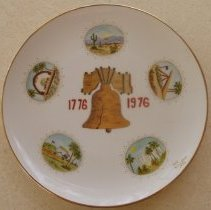 """Image of Sun City General - Liberty Bell ceramic plate made by Fay Cochran in 1976.  Hand written on back of plate states:  """"This is one of 3 plates painted for Del E. Webb Company.  Fay Cochran."""""""