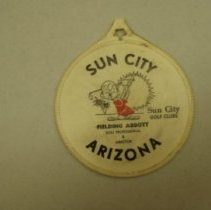 "Image of Sun City General - One plastic emblem, possibly to put on golf bag saying""Sun City Arizona Sun City Golf Clubs. Writing on both sides. Emblem has Larry Parker as General Manager of Sun City Golf Courses."