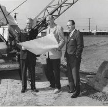 Image of Plans reviewed in front of equipment - Plans reviewed in front of equipment.  Left to right:  Barney Burns, County Supervisor; Ralph Hauer, Architect; Tom Breen, Webb executive.