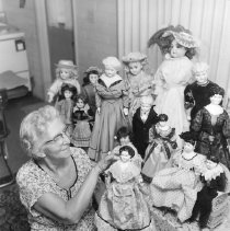 Image of Hobbies - Eunice Howard showing her doll collection.