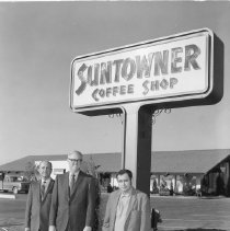 Image of Restaurants - Suntowner opening: Owen Childress DEVCO in the middle, on the left is DEVCO food manager, name unknown and on the right restaurant manager, name unknown.