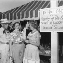 Image of Western Days - Western Days booth collecting donations.